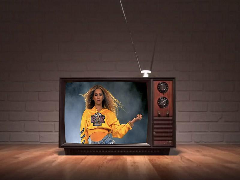 Beyoncé performing at Coachella through an old tv set