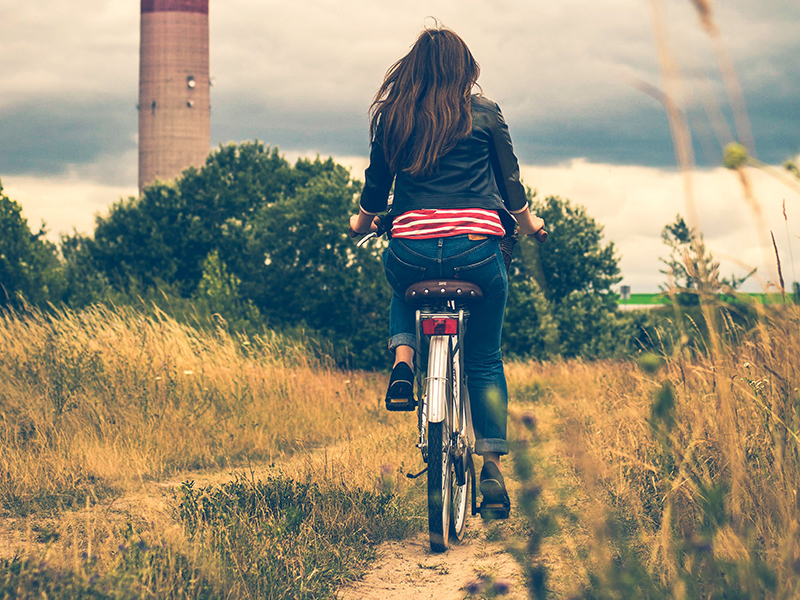 girl being fearless riding bike