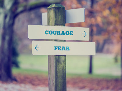 direcrtional sign courage over everything