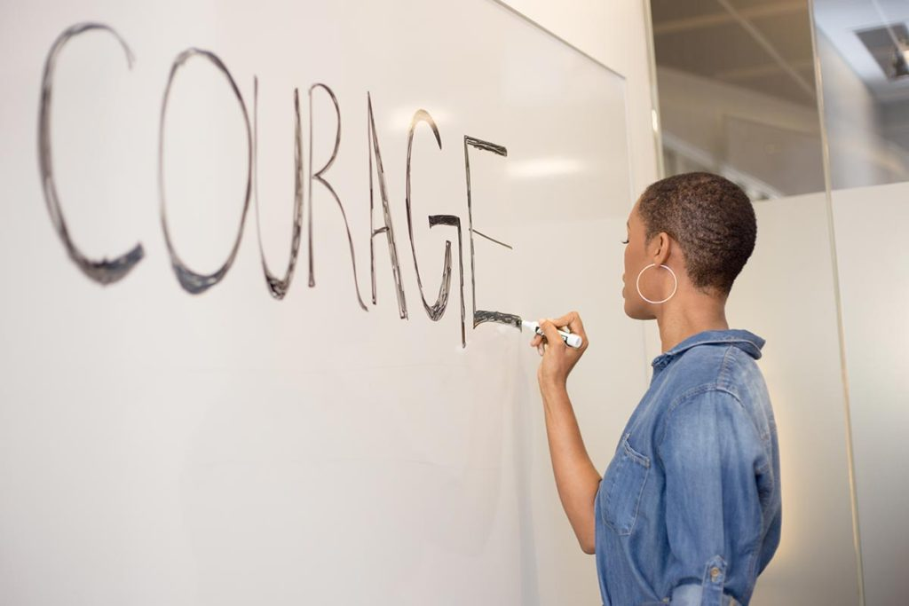 Bravery does not equal courage. Writing on chalkboard.